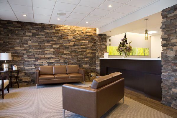 The lobby and the front desk at Maple Ridge Dental.